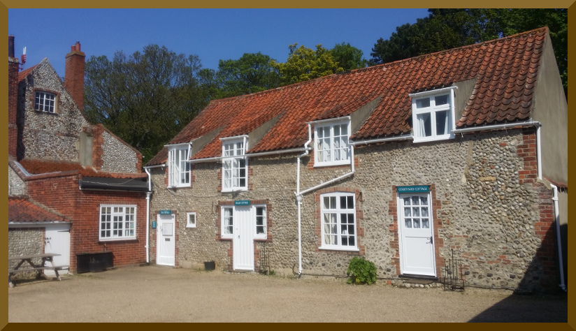 The two Friary Farm Cottages and the Site office in glorious May sun.